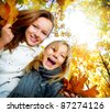 Beautiful Teenage Girls Having Fun in Autumn Park .Outdoor - stock photo