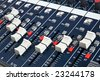 Close-up of sound mixer console faders. Macro background 04 - stock photo