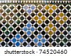 Colorful tiles decorating a wall of the Alhambra - stock photo