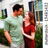 Happy, Smiling Young Couple In Front Of Their New Home - stock photo