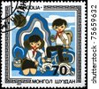 "MONGOLIA - CIRCA 1983: A Stamp printed in MONGOLIA shows the Boy and Girl, from the series ""Children in Various Activities"", circa 1983 - stock photo"