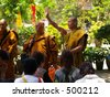 Monks at the Big Buddha in Lantau Island, Hong Kong - stock photo