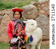 Peruvian girl in traditional dress at ruins with bird and lama in Cusco, Peru. - stock photo