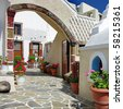 pretty courtyards of Santorini - stock photo