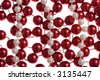 Read and white beads isolated o a white background - stock photo