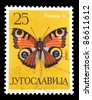 "YUGOSLAVIA - CIRCA 1964: A stamp printed in Yugoslavia shows butterfly with the inscription ""Vanessa io"" from the series ""Butterflies"", circa 1964 - stock photo"